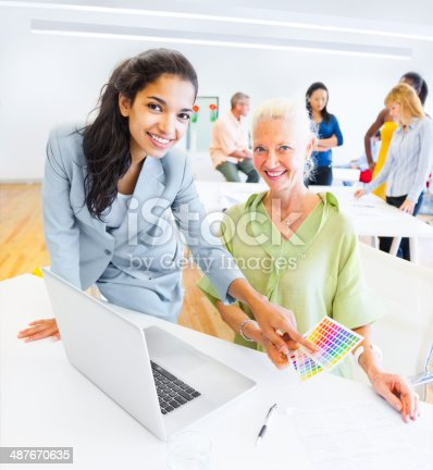 487670635istockphoto Designer Choosing a Color from the Color Swatch 487670635