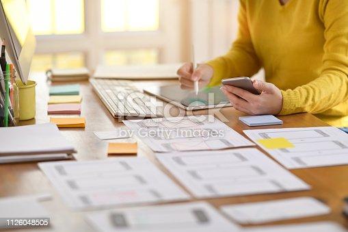 UX designer creative planning application development for web mobile phone in studio