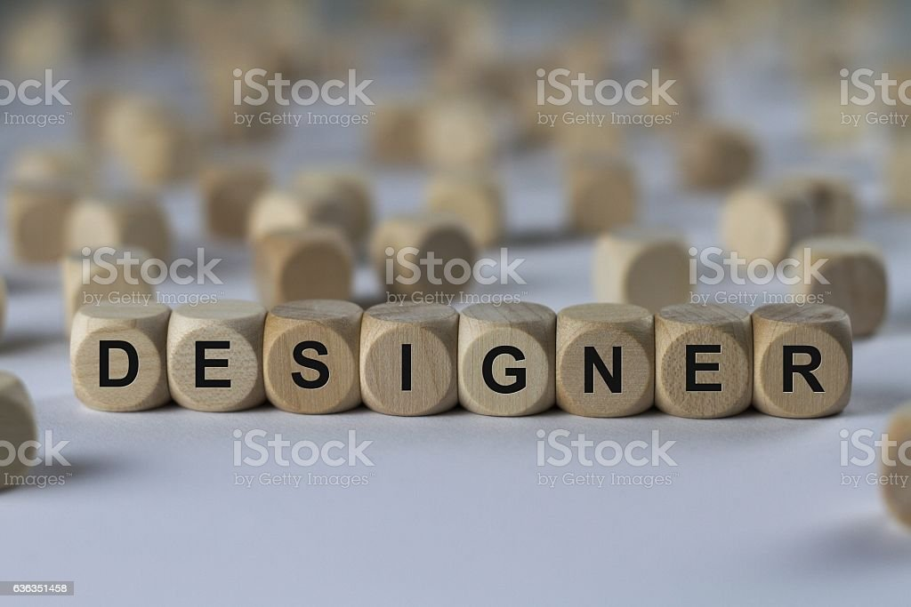 designer - cube with letters, sign with wooden cubes stock photo