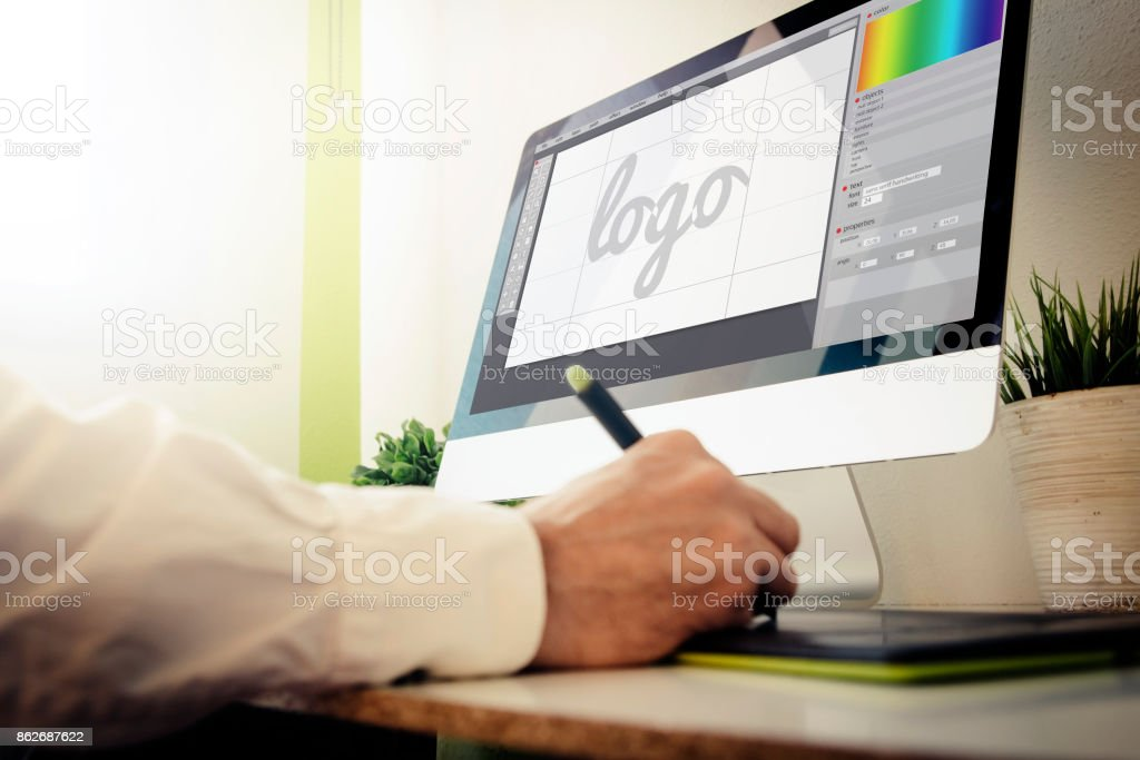 designer designing a logo stock photo