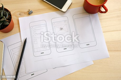 istock Designer desk with UI wireframe sketches 532385848