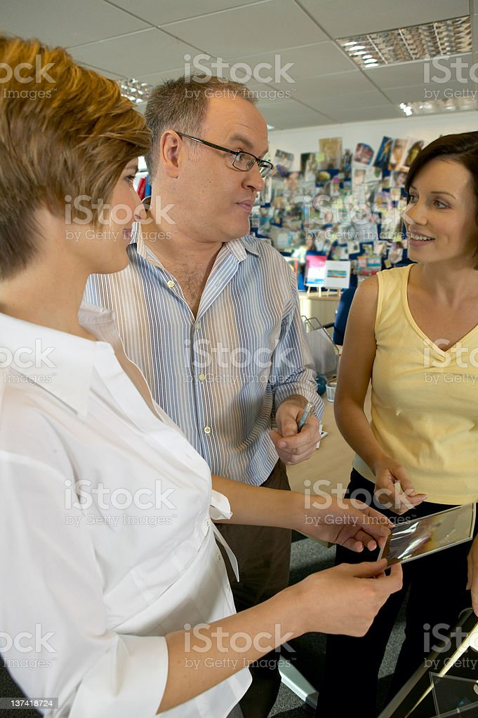 Designer discussing a project.N.B* All Artwork/Imagery mocked up! royalty-free stock photo