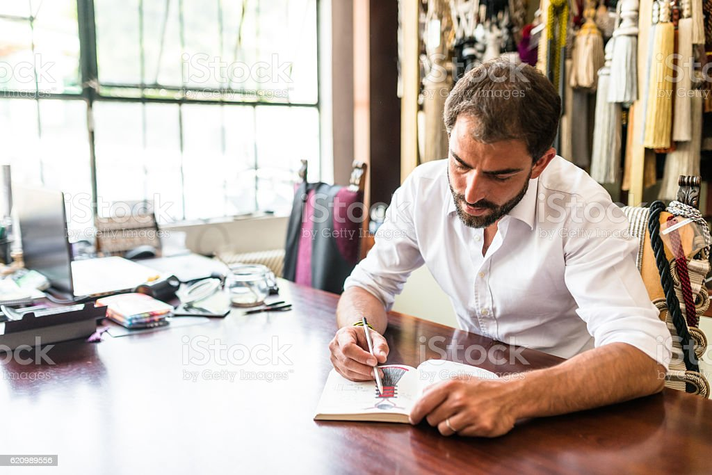 designer doing a sketch on his factory stock photo