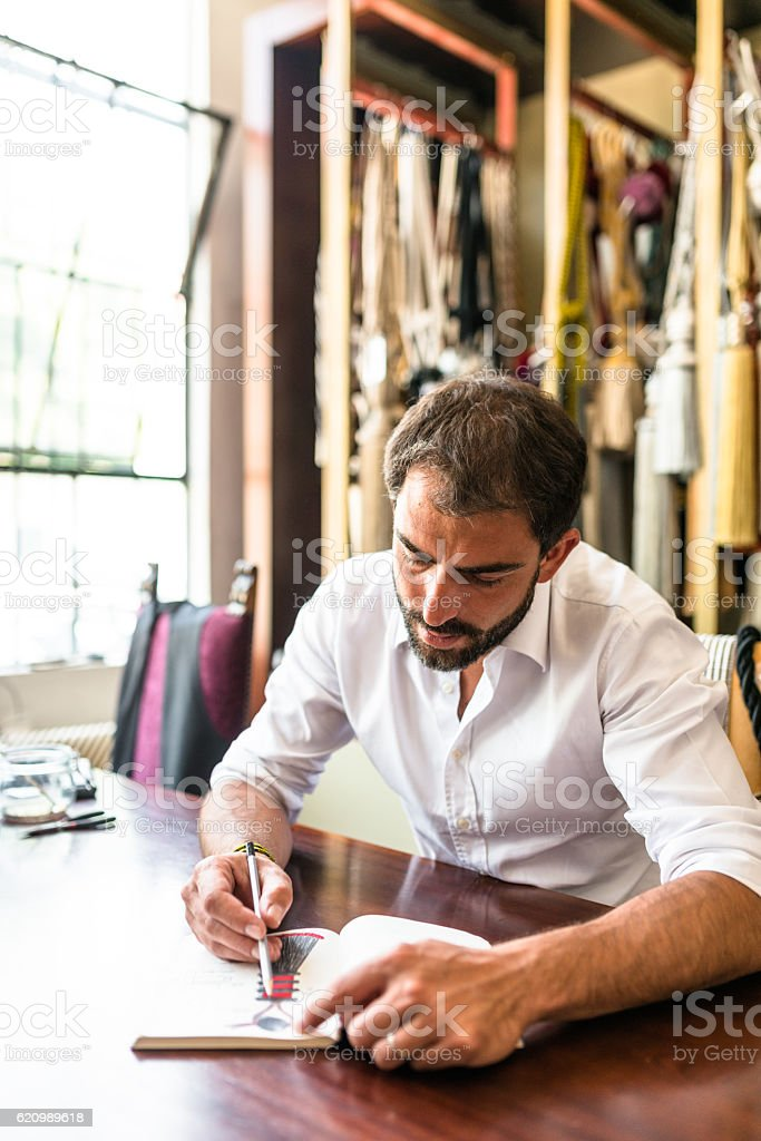 designer doing a sketch on his factory foto royalty-free