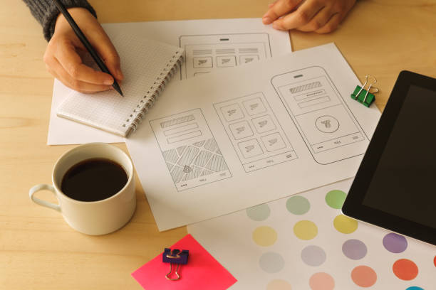 Designer drawing mobile App wireframes stock photo