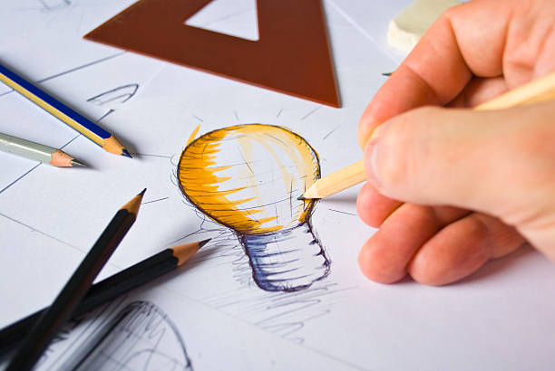 designer drawing - advertisement stock photos and pictures