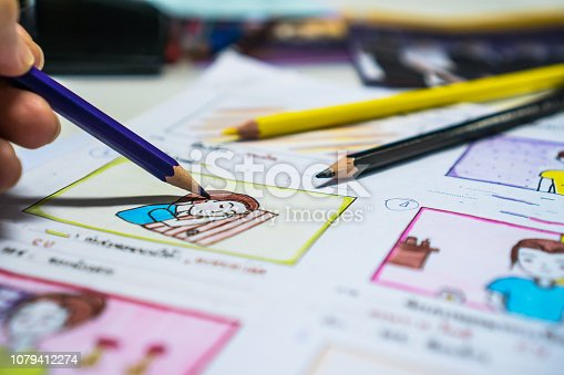 istock Designer drawing Story board movie video layout for pre-production, development cartoon illustration animation for process media films in form displayed script film production. Media product concept. 1079412274