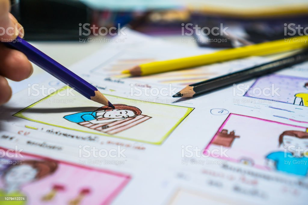 Designer drawing Story board movie video layout for pre-production, development cartoon illustration animation for process media films in form displayed script film production. Media product concept. стоковое фото