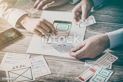 istock Designer drawing website ux app development. 628609112