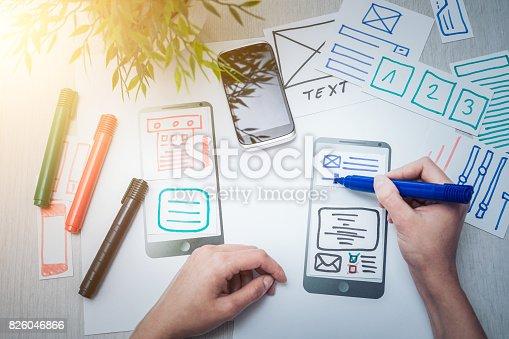 826047464 istock photo Designer drawing website ux app development. 826046866