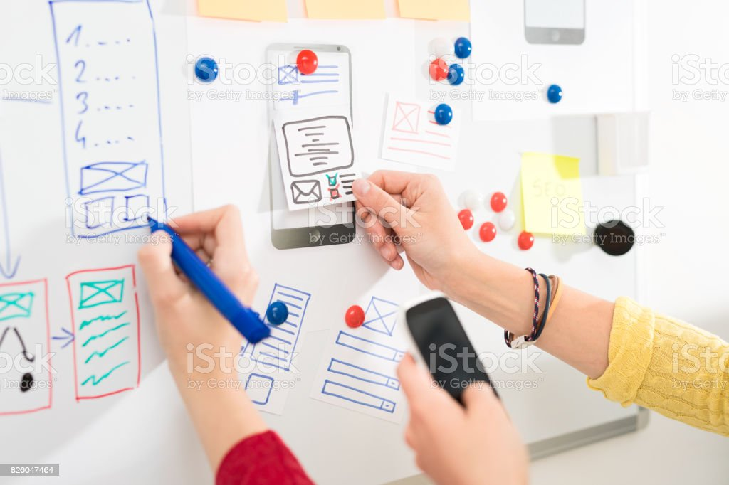 Designer drawing website ux app development. stock photo