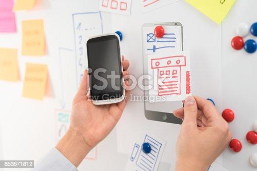 826047464 istock photo Designer drawing website ux app development. 853571812