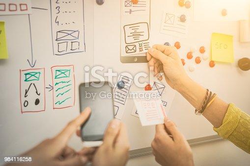 istock Designer drawing website ux app development. 984116258