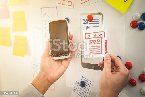 istock Designer drawing website ux app development. 984126396