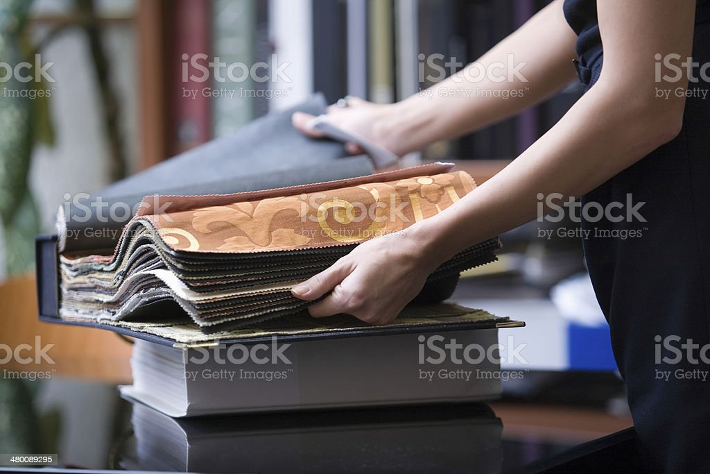 Designer Going Through Fabric Samples stock photo