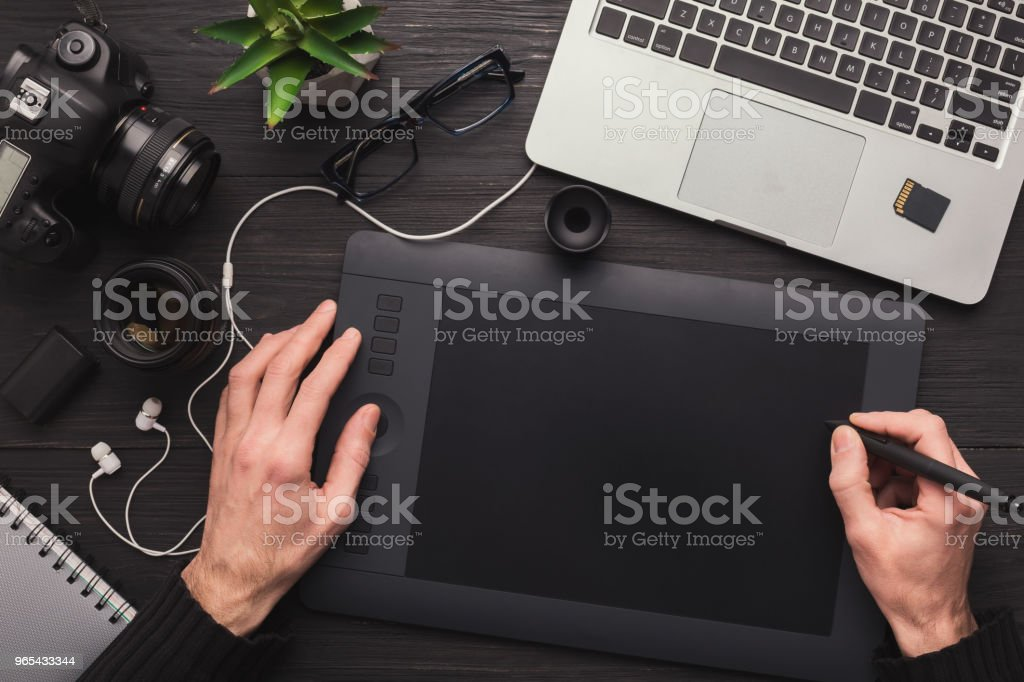Designer hand with graphic tablet and keyboard royalty-free stock photo