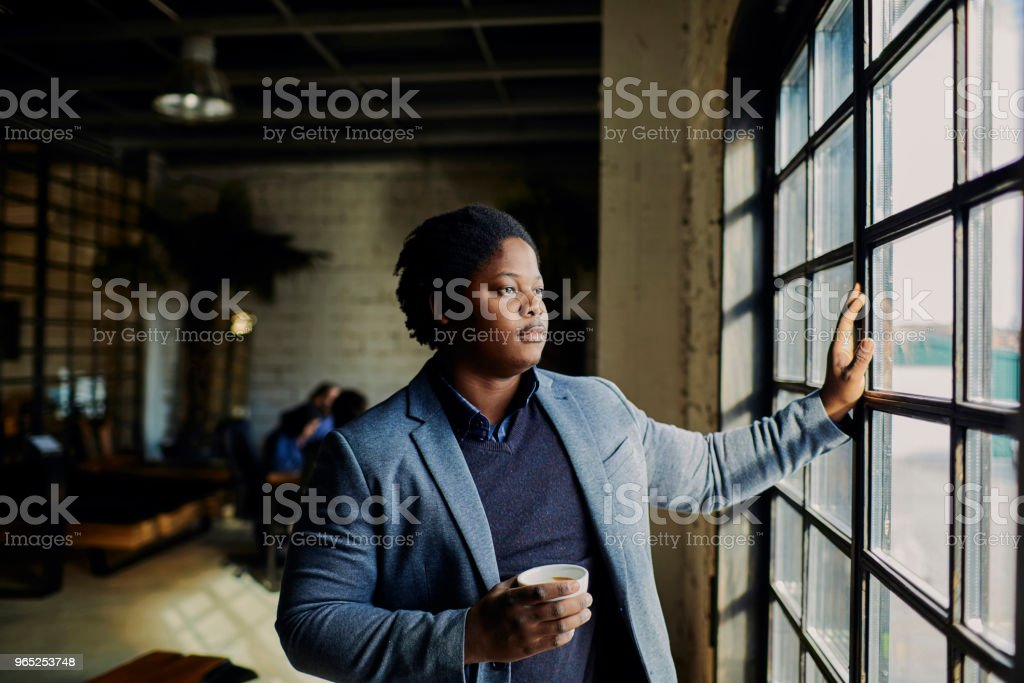 Designer having a cup of coffee royalty-free stock photo