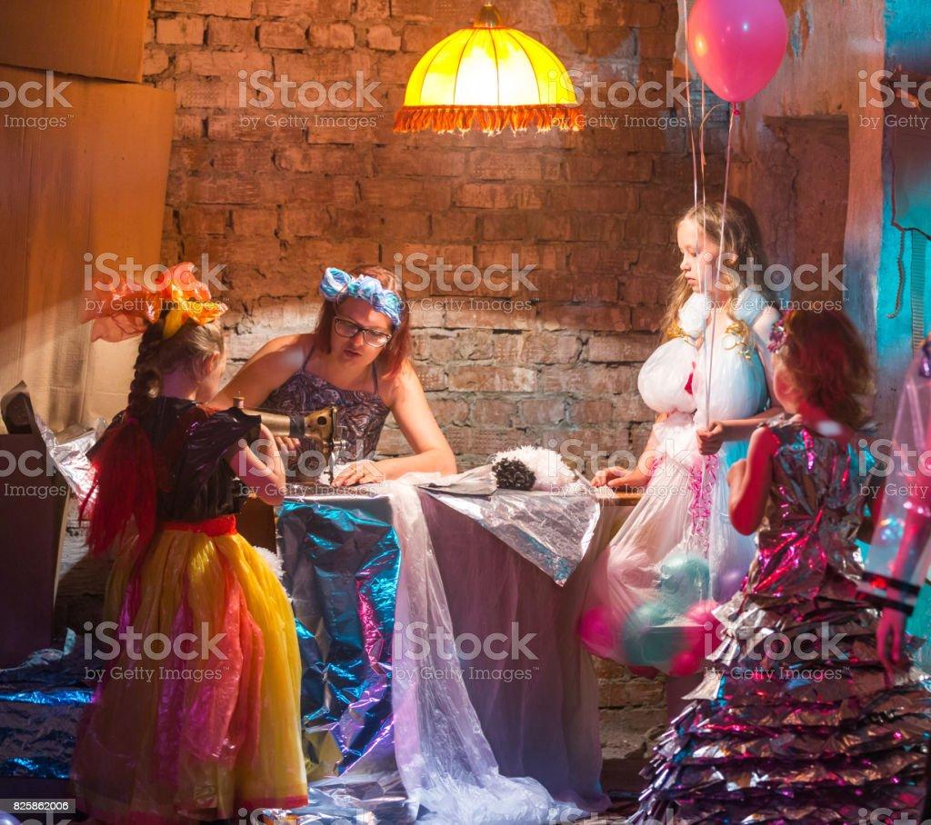 Designer Is Creating Eko Costumes for Three Cute Girls stock photo