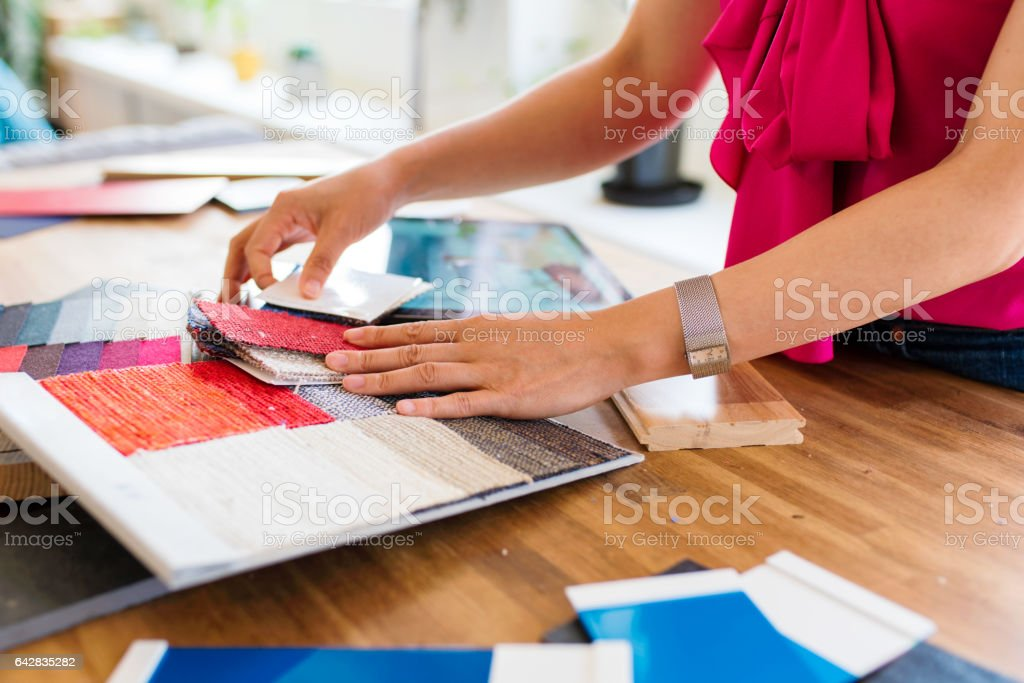 Designer looking at colour swatches stock photo