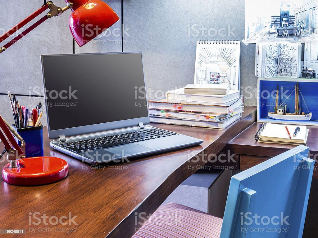 Designer modern home office desk with laptop and equipment stock photo
