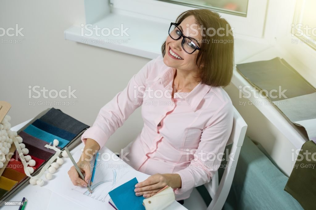 Designer Or Architect Posing And Looking At You Sitting In The Office With  A Window In
