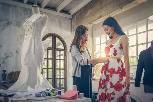 Designer Clothing And Designer Industry fashion designer stock pictures, royalty-free photos & images