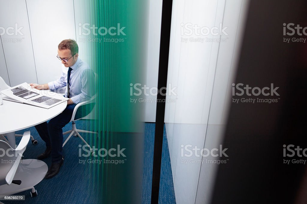 Designer reviewing book in office stock photo