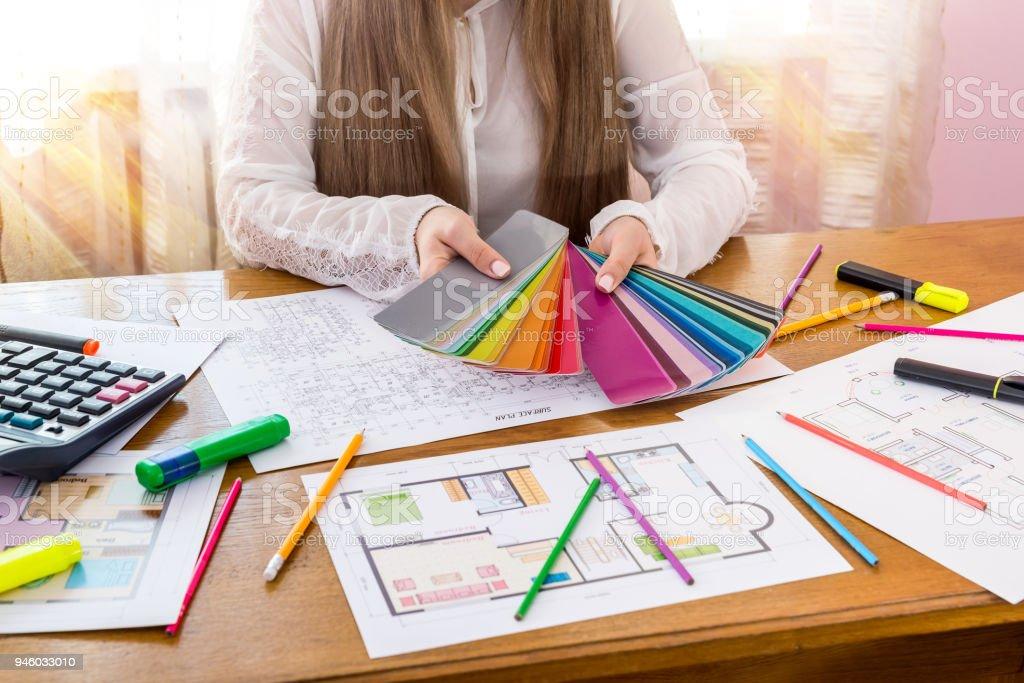 Designer showing colour swatch, choose colour for renovation stock photo