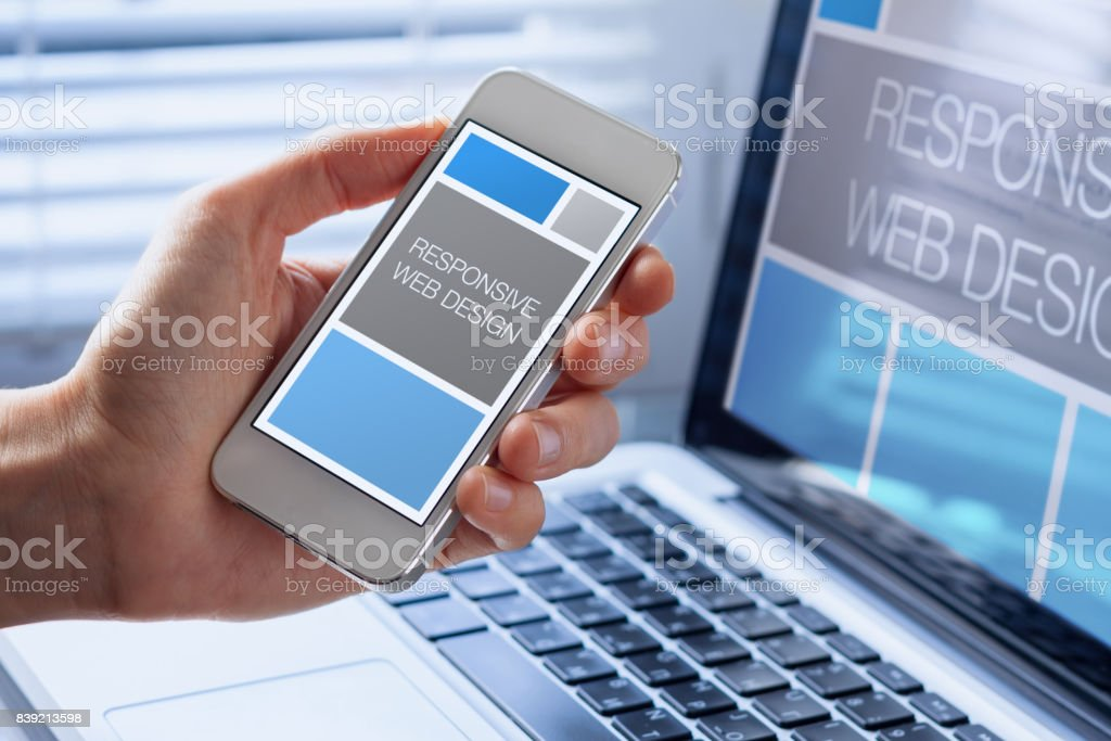 Designer sketching responsive web design website, smartphone screen, fluid grid stock photo