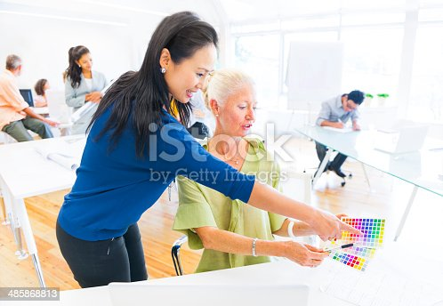 487670635istockphoto Designer Suggesting in which Color from the Color Swatch 485868813