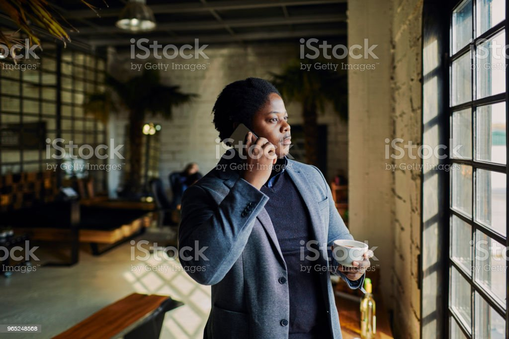 Designer talking on the phone royalty-free stock photo