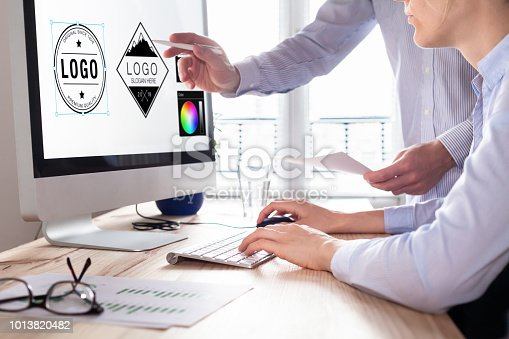 istock Designer team sketching a logo in digital design studio on computer, creative graphic drawing skills for marketing and branding 1013820482