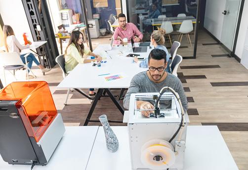 istock Designer using a 3D printer 1021334650