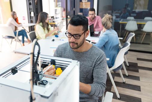 istock Designer using a 3D printer 1021334670