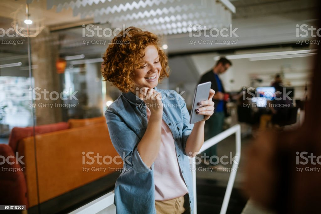 Designer using a phone - Royalty-free 20-29 Years Stock Photo