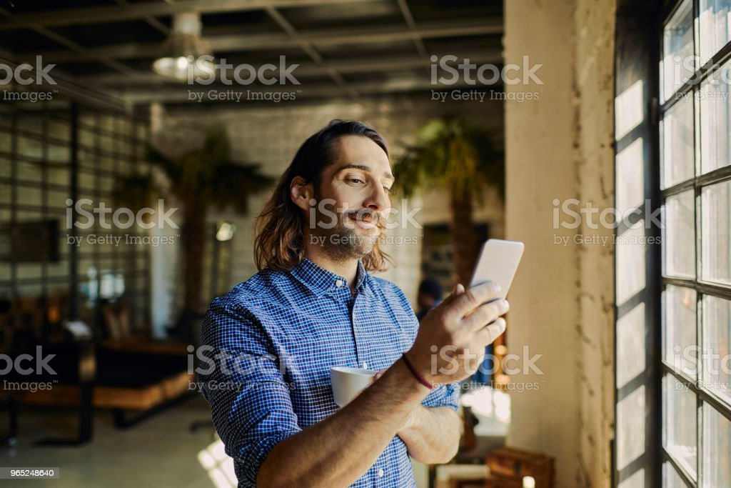 Designer using a phone royalty-free stock photo