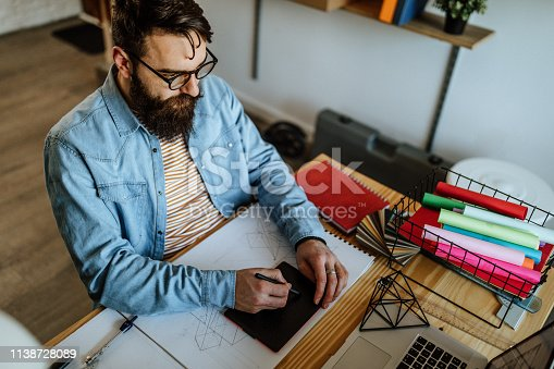 90871912istockphoto Designer using graphics tablet 1138728089
