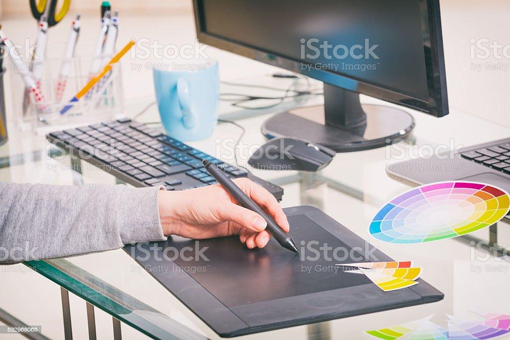 Designer using graphics tablet stock photo