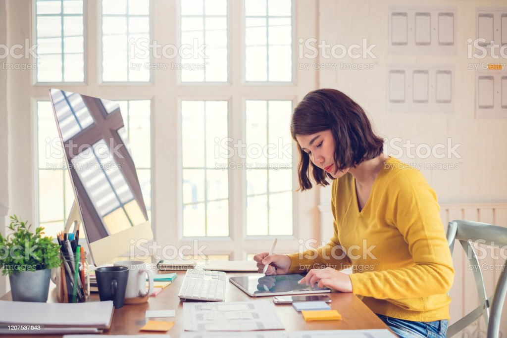 Designer woman drawing a website outline and website ux app development on mobile phone. Designer woman drawing a website outline and website ux app development on mobile phone. Accessibility Stock Photo