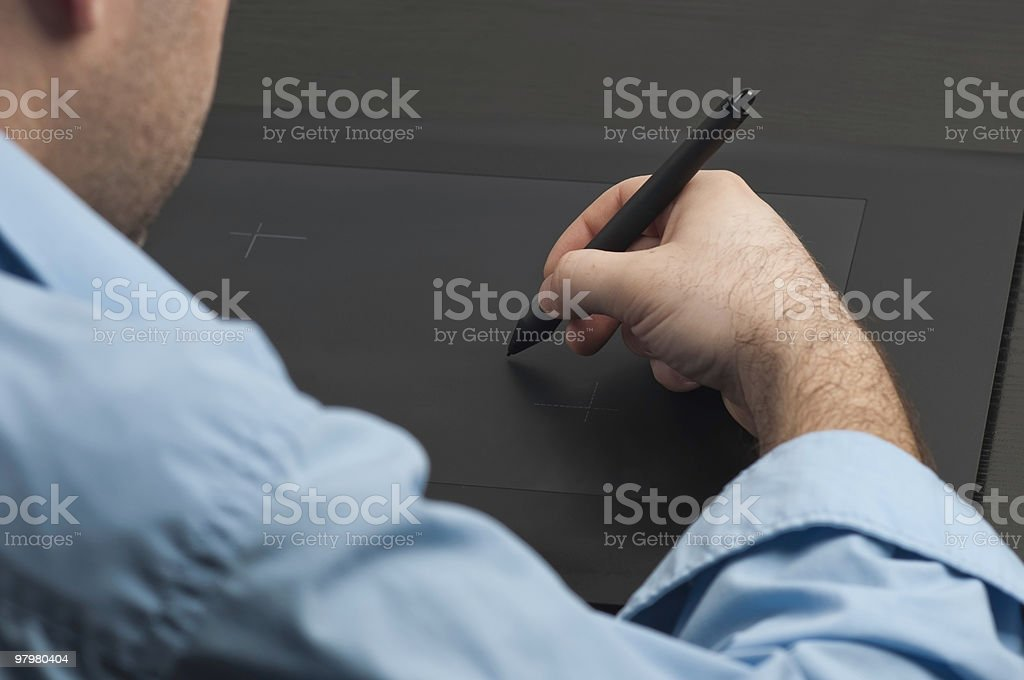 Designer work with a tablet in front of  laptop royalty-free stock photo