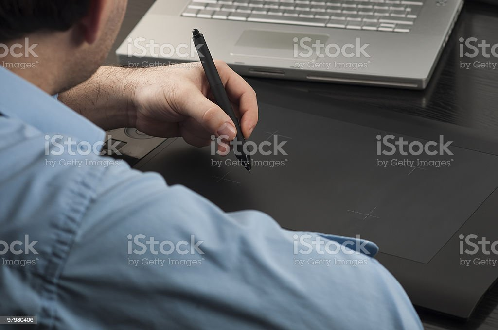 Designer work with a tablet in front of your laptop royalty-free stock photo