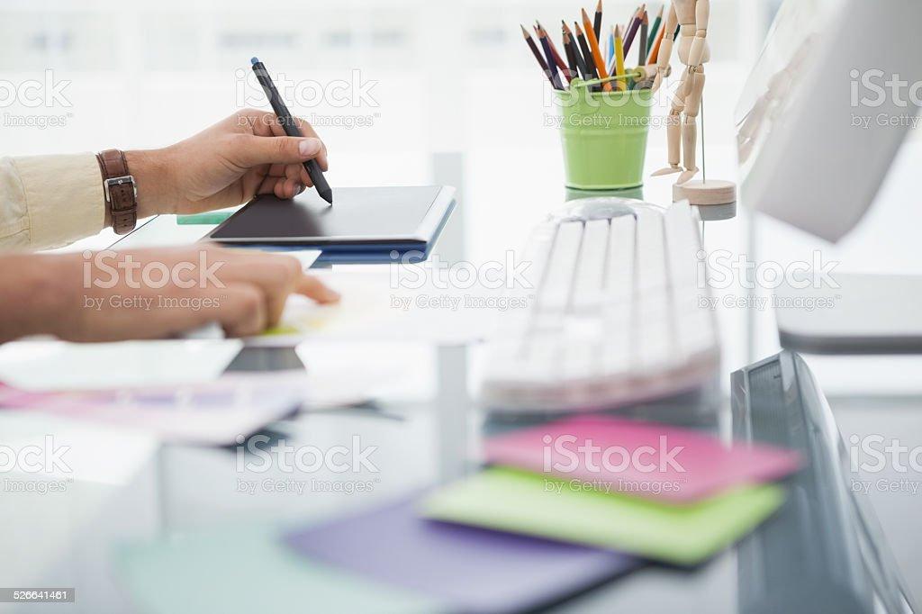 Designer working at desk using digitizer stock photo