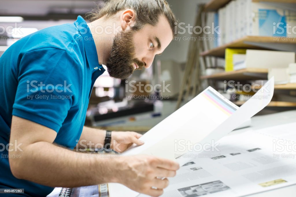 Designer working at printing industry stock photo