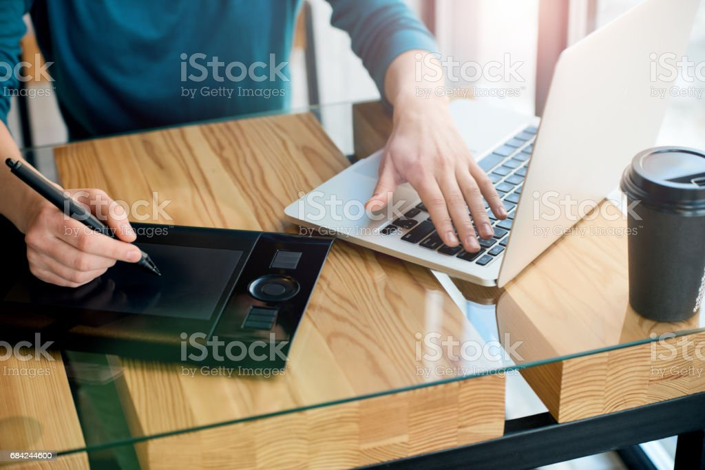 Designer working on computer with graphic pen royalty-free stock photo