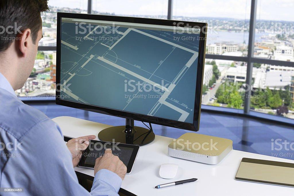 Designer working on tablet stock photo