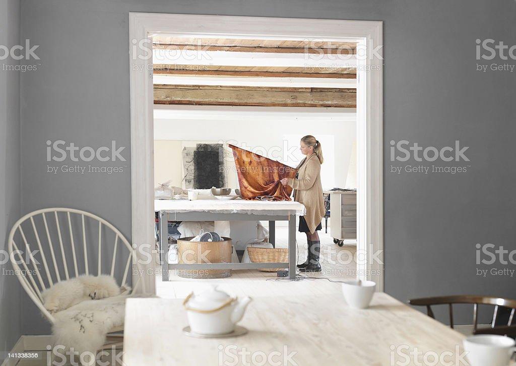 Designer working with textiles in studio stock photo