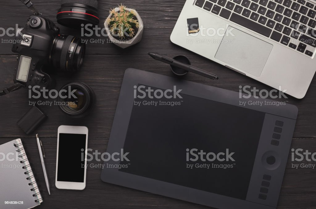 Designer workplace with graphic tablet and laptop royalty-free stock photo