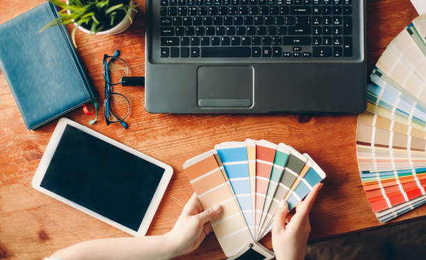 Designer works from home on the table. The desktop of the interior designer. Color palette. stock photo