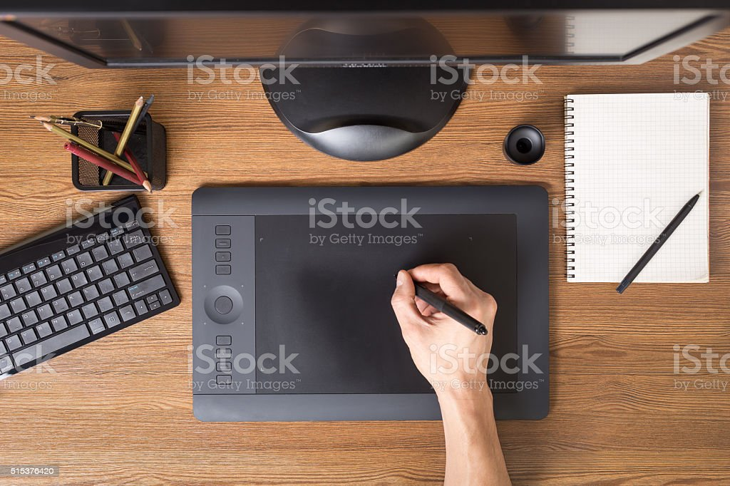 Designer workspace with tablet, keyboard, computer stock photo