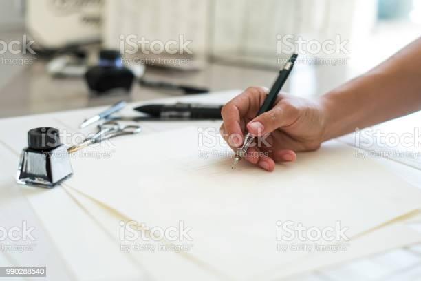 Designer writing logo designers hand holding a pen and writing logo picture id990288540?b=1&k=6&m=990288540&s=612x612&h=vr5julngoloilf0 ctfnyq1hzvqkvxu2vvgzpffznay=